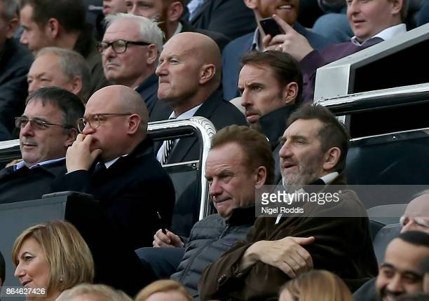 Gareth Southgate manager of England musician Sting and actor Jimmy Nail look on from the stands during the Premier League match between Newcastle...