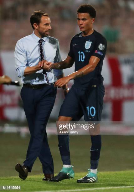 Gareth Southgate manager of England shakes hands with Dele Alli of England as he is substituted during the FIFA 2018 World Cup Qualifier between...
