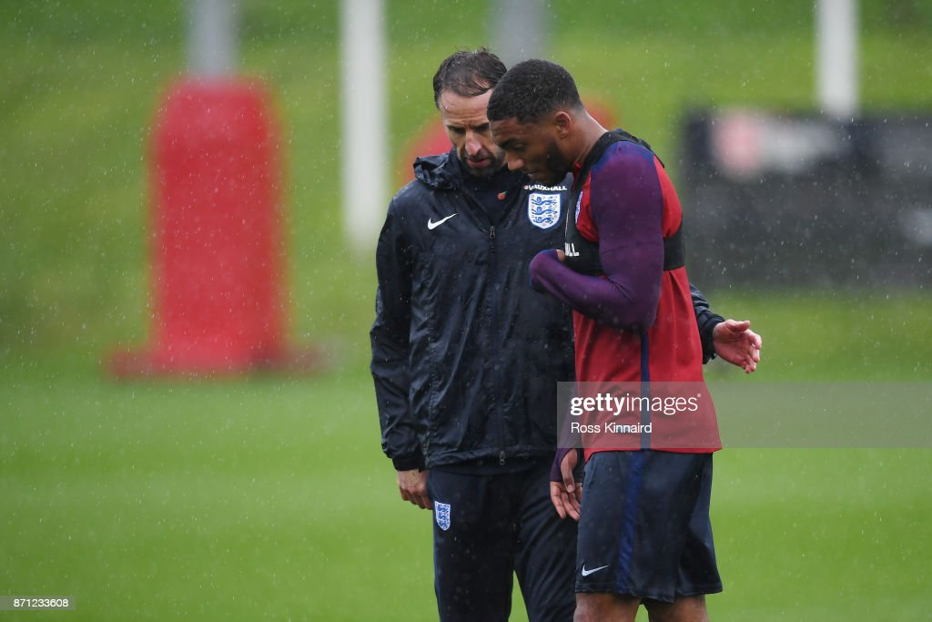 Gareth Southgate, manager of England speaks with Joseph Gomez of England during an England training session at St Georges Park on November 7, 2017 in Burton-upon-Trent, England.