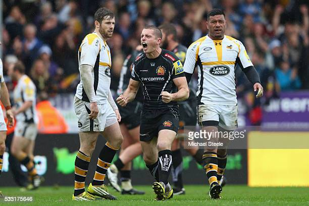 Gareth Steenson of Exeter Chiefs celebrates his sides second try as Elliot Daly and Charles Piutau of Wasps look on during the Aviva Premiership semi...