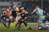 Gareth Steenson of Exeter Chiefs is held up by Marcos Ayerza of Leicester Tigers during the Aviva Premiership match between Exeter Chiefs and...