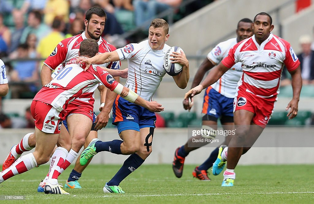 Gareth Stoppani of New York breaks with the ball to score a try against Gloucester in the Plate final during the World Club 7's at Twickenham Stadium on August 18, 2013 in London, England.