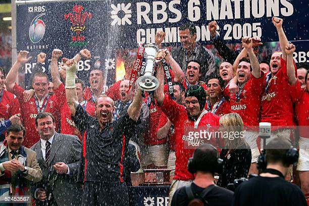 Gareth Thomas and Michael Owen hold aloft the trophy after winning the Grand Slam by beating Ireland in the RBS Six Nations International between...