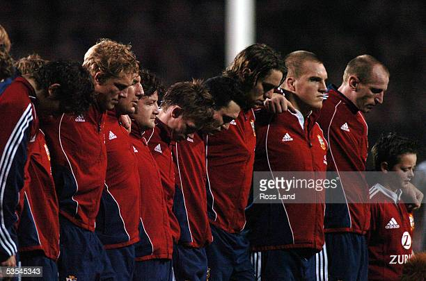 Gareth Thomas and team mates observe a minutes silence in honor of the London bombing victims prior to the All Blacks 3819 win over the British and...