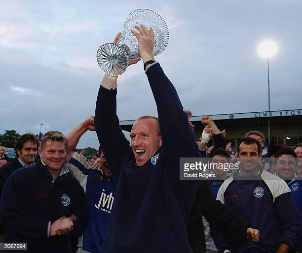 Gareth Thomas the Bridgend club captain lifts the Welsh Premiership Trophy during the Welsh Premiership match between Bridgend and Neath on May 20...
