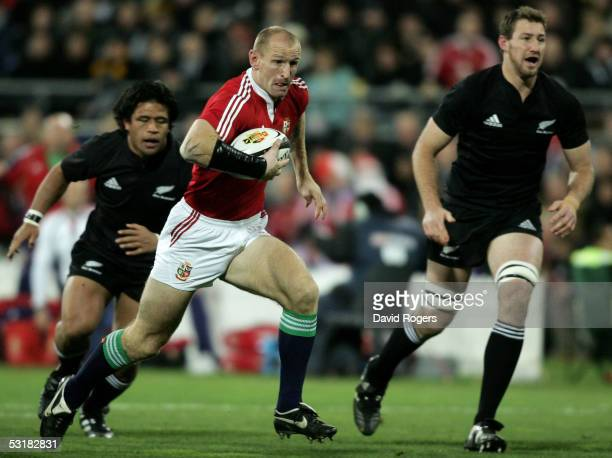 Gareth Thomas the Lions captain races away to score the first try during the second test match between The New Zealand All Blacks and the British and...
