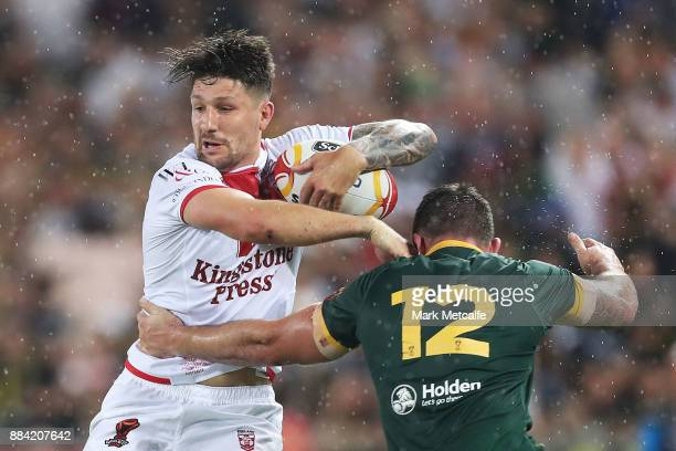 Gareth Widdop of England is tackled by Matt Gillett of Australia during the 2017 Rugby League World Cup Final between the Australian Kangaroos and...