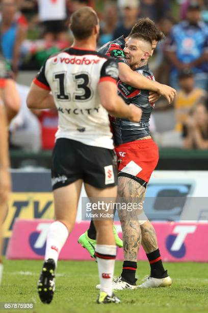 Gareth Widdop of the Dragons congratulates Josh Dugan of the Dragons as he celebrates scoring a try during the round four NRL match between the St...