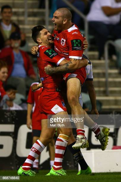 Gareth Widdop of the Dragons is congratulated by Russell Packer of the Dragons after scoring a try during the round seven NRL match between the St...