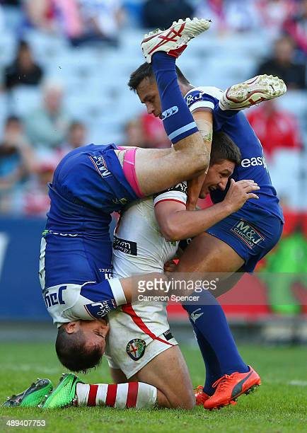 Gareth Widdop of the Dragons is tacked by Josh Reynolds of the Bulldogs and Sam Perrett of the Bulldogs during the round nine NRL match between the...