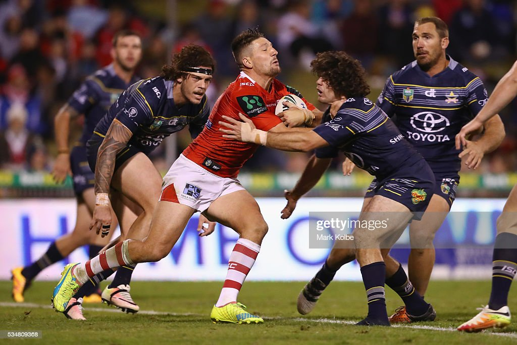 <a gi-track='captionPersonalityLinkClicked' href=/galleries/search?phrase=Gareth+Widdop&family=editorial&specificpeople=6349002 ng-click='$event.stopPropagation()'>Gareth Widdop</a> of the Dragons is tackled by Jake Granville of the Cowboys during the round 12 NRL match between the St George Illawarra Dragons and the North Queensland Cowboys at WIN Jubilee Stadium on May 28, 2016 in Wollongong, Australia.