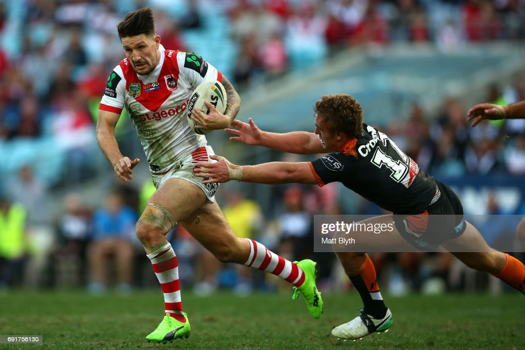 Gareth Widdop of the Dragons is tackled during the round 13 NRL match between the St George Illawarra Dragons and the Wests Tigers at ANZ Stadium on June 3, 2017 in Sydney, Australia.