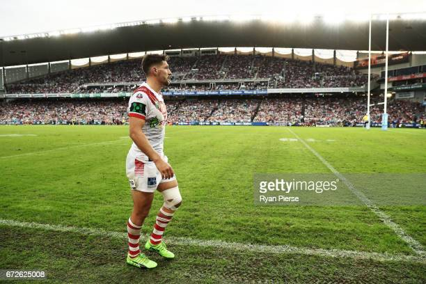 Gareth Widdop of the Dragons leaves the ground with an injury during the round eight NRL match between the Sydney Roosters and the St George...