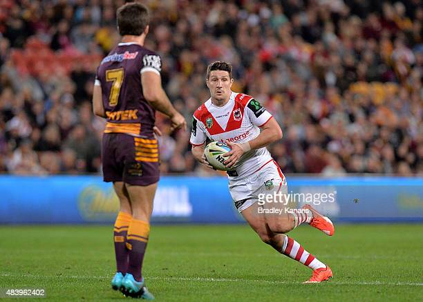 Gareth Widdop of the Dragons looks to take on the defence during the round 23 NRL match between the Brisbane Broncos and the St George Illawarra...