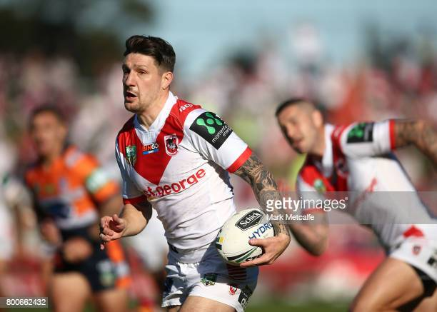 Gareth Widdop of the Dragons makes a break during the round 16 NRL match between the St George Illawarra Dragons and the Newcastle Knights at UOW...