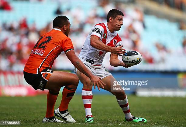 Gareth Widdop of the Dragons passes during the round one NRL match between the St George Illawarra Dragons and the Wests Tigers at ANZ Stadium on...