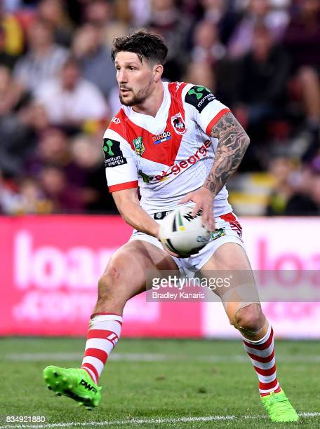 Gareth Widdop of the Dragons passes the ball during the round 24 NRL match between the Brisbane Broncos and the St George Illawarra Dragons at...