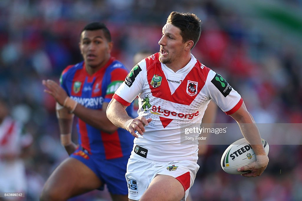 <a gi-track='captionPersonalityLinkClicked' href=/galleries/search?phrase=Gareth+Widdop&family=editorial&specificpeople=6349002 ng-click='$event.stopPropagation()'>Gareth Widdop</a> of the Dragons runs the ball during the round 16 NRL match between the Newcastle Knights and the St George Illawarra Dragons at Hunter Stadium on June 25, 2016 in Newcastle, Australia.