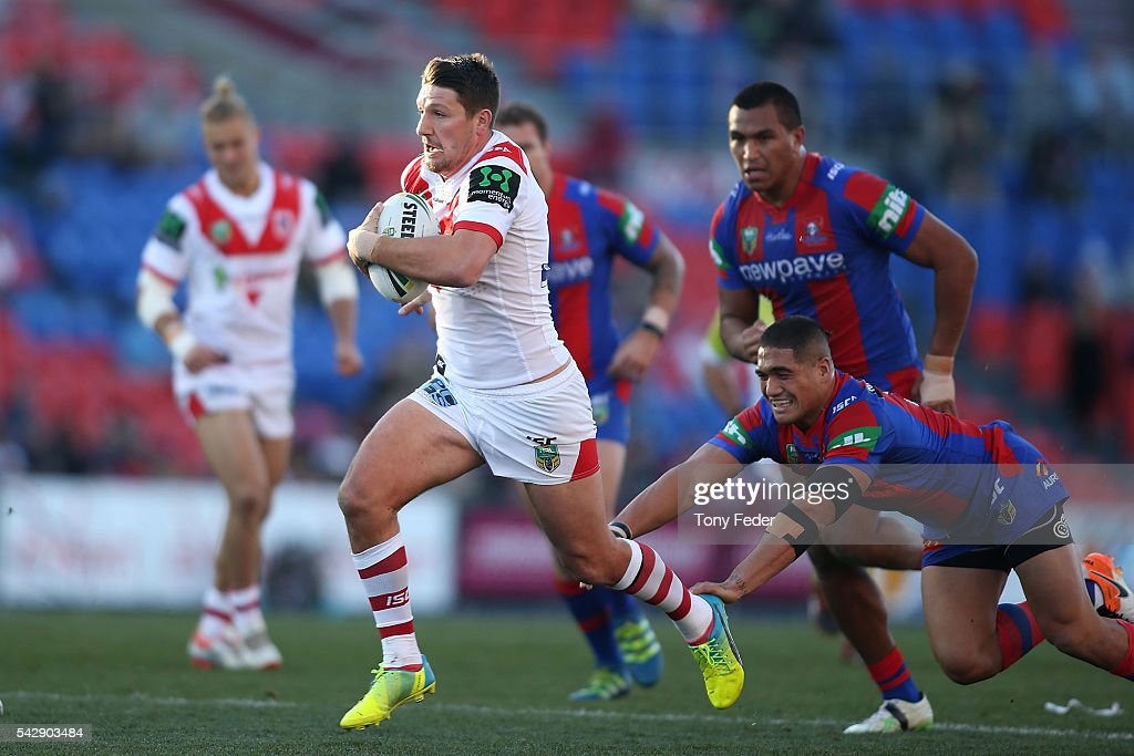 Gareth Widdop of the Dragons runs the ball during the round 16 NRL match between the Newcastle Knights and the St George Illawarra Dragons at Hunter Stadium on June 25, 2016 in Newcastle, Australia.