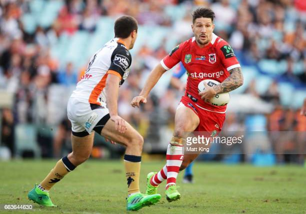 Gareth Widdop of the Dragons takes on the defence during the round five NRL match between the Wests Tigers and the St George Illawarra Dragons at ANZ...