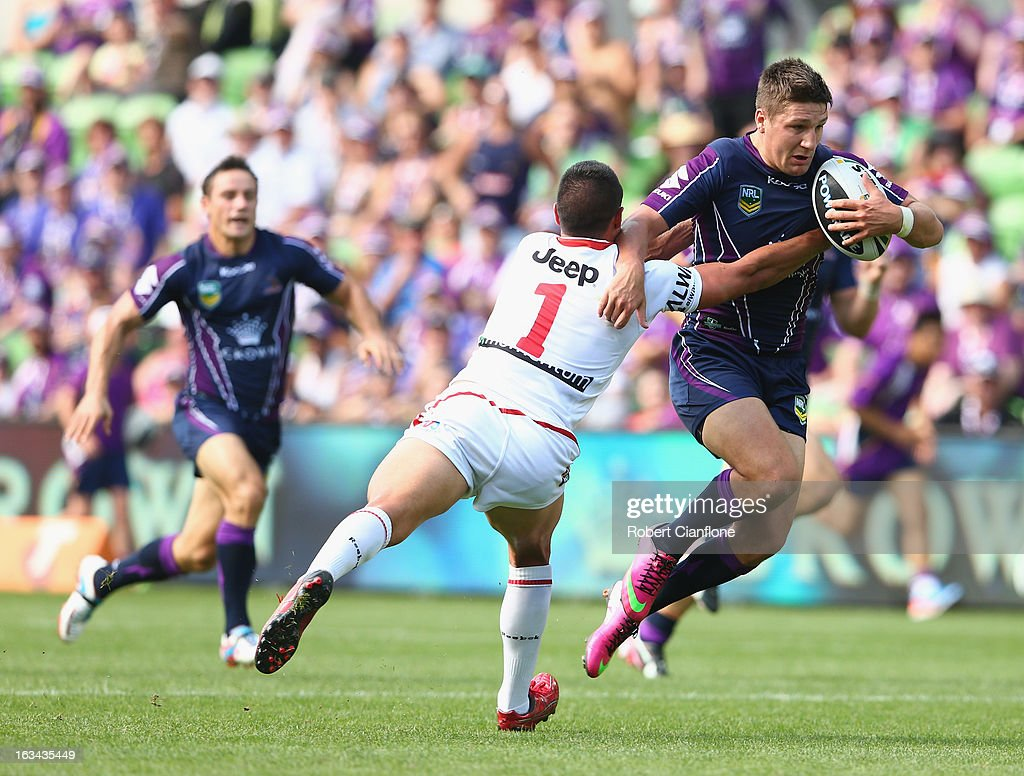 Gareth Widdop of the Storm is challenged by Gerard Beale of the Dragons during the round one NRL match between the Melbourne Storm and the St George Illawarra Dragons at AAMI Park on March 10, 2013 in Melbourne, Australia.