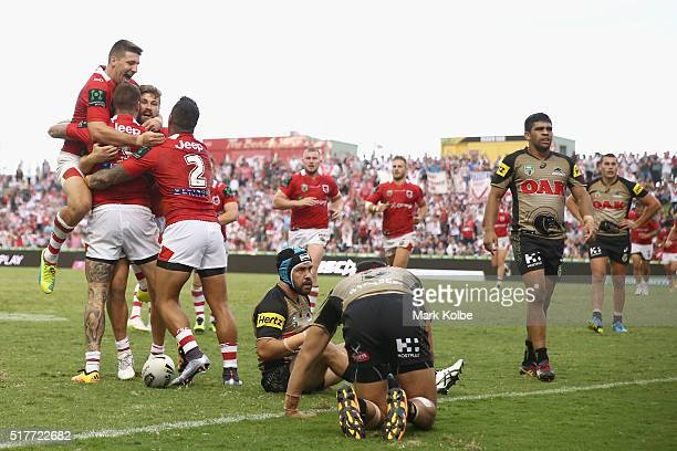 Gareth Widdop Will Matthews and Peter Mata'utia of the Dragons congratulate Josh Dugan of the Dragons as he celebrates scoring a try during the round...
