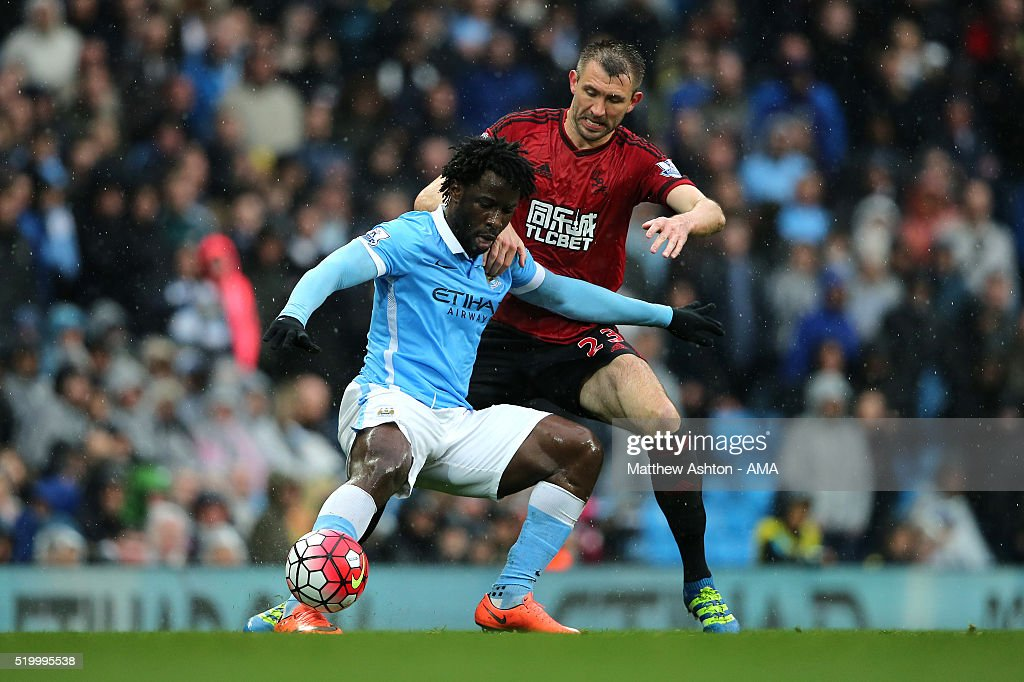 Garetrh McAuley of West Bromwich Albion tangles with Wilfried Bony of Manchester City during the Barclays Premier League match between Manchester City and West Bromwich Albion at Etihad Stadium on April 9, 2016 in Manchester, England