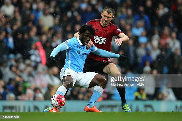 Garetrh McAuley of West Bromwich Albion tangles with Wilfried Bony of Manchester City during the Barclays Premier League match between Manchester...