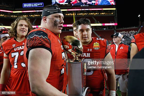 Garett Bolle and Kyle Lanterman of the Utah Utes with the trophy after a win against the Indiana Hoosiers in the Foster Farms Bowl game at Levi's...