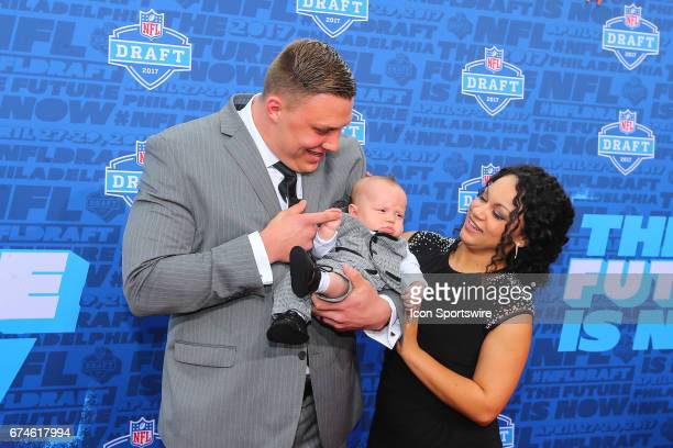 Garett Bolles from Utah along with his wife Natalie and their son Kingston on the Red Carpet outside of the NFL Draft Theater on April 27 2017 in...
