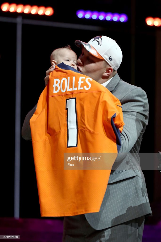 Garett Bolles of Utah kisses his son Kingston after being picked #20 overall by the Denver Broncosduring the first round of the 2017 NFL Draft at the Philadelphia Museum of Art on April 27, 2017 in Philadelphia, Pennsylvania.