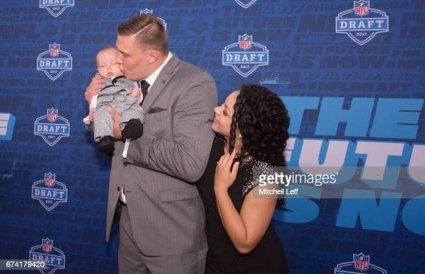 Garett Bolles of Utah pose for a picture with his wife Natalie Bolles and child on the red carpet prior to the start of the 2017 NFL Draft on April...