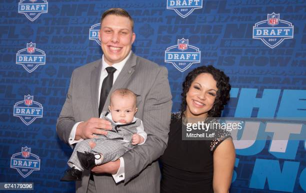 Garett Bolles of Utah poses for a picture with his wife Natalie Bolles and child on the red carpet prior to the start of the 2017 NFL Draft on April...