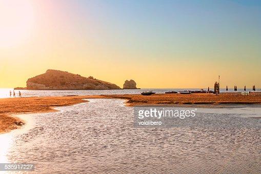 SEASCAPE SUMMER. Gargano coast: low tide at dawn. Vieste (Puglia)ITALY : Stock Photo