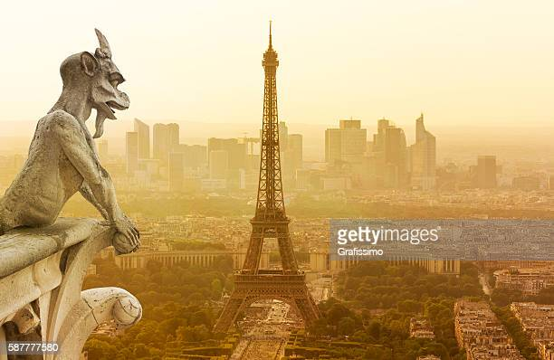 Gargoyle figur on Notre Dame looking towards Eiffel Tower