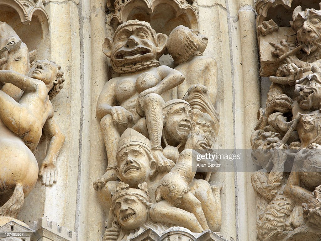 Gargoyles on the entrance to Notre Dame Cathedral : Stock Photo