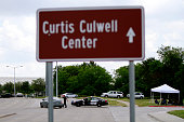 Garland Police car is parked near a road sign informing the location of the Curtis Culwell Center after a shooting occurred the day before May 04...