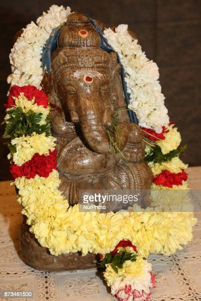 Garlanded idol of Lord Ganesh at a Tamil Hindu Temple in Brampton Ontario Canada