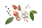 Garlic, bay leaves, allspice and pepper isolated on white background. Top view