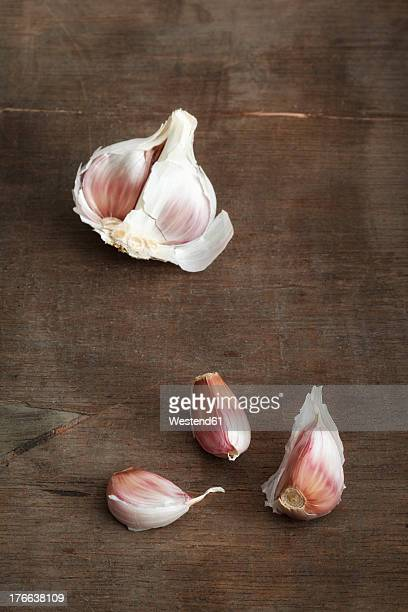 Garlic clove on wooden table, close up