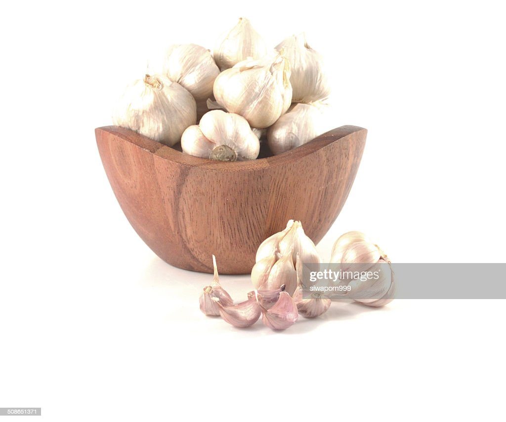 garlic in bowl  isolate on white : Stock Photo
