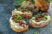 Garlic mushroom toast with creamy herbed ricotta chees spread.