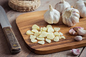 Garlic on wooden cutting board