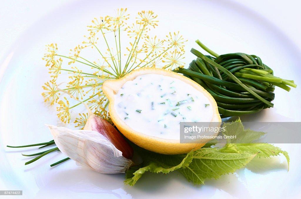 Garlic sauce in hollowed-out lemon; ingredients