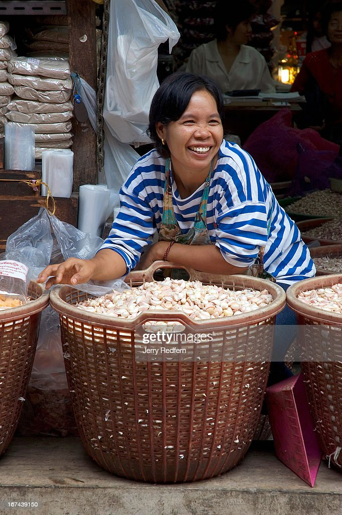 A garlic vendor jokes with passers-by at Pak Khlong Talat, a huge fresh-goods market in the center of Bangkok..
