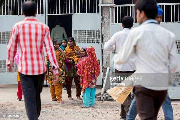 Garment factory workers gather outside an entrance to a factory during their lunch break in the Savar district of Dhaka Bangladesh on Tuesday Jan 7...