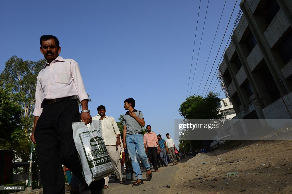 Garment industry workers going for work in Udyog Vihar photographed on May 26, 2013 in Gurgaon, India.