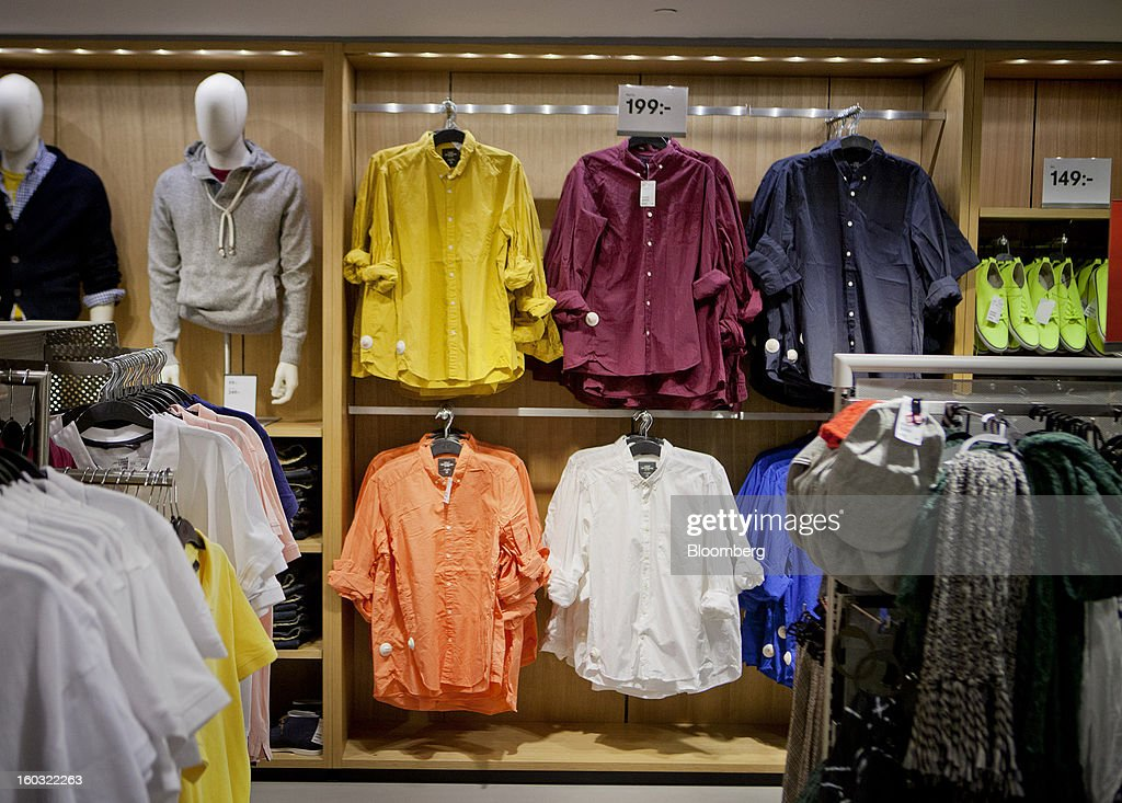 Garments sit on display inside a Hennes & Mauritz AB (H&M) store in Stockholm, Sweden, on Tuesday, Jan. 29, 2013. Hennes & Mauritz AB, Europe's second-largest clothing retailer, reported sales growth that beat analysts' estimates for a second consecutive month as the chain offered markdowns in advance of the Christmas holiday. Photographer: Casper Hedberg/Bloomberg via Getty Images