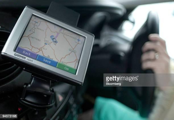 Garmin satellite navigation system sits on display in a car in Norfolk UK on Wednesday Oct 31 2007 Garmin Ltd the biggest US maker of car navigation...