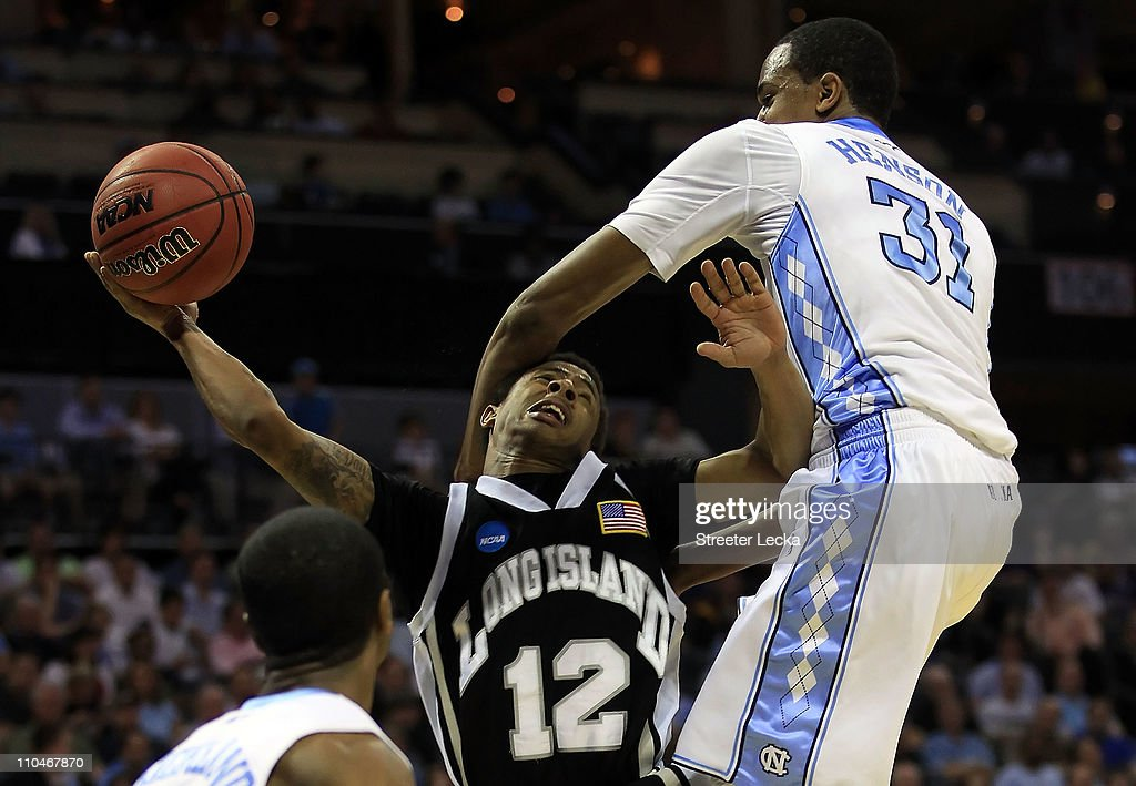 C.J. Garner #12 of the Long Island Blackbirds goes up for a shot against John Henson #31 of the North Carolina Tar Heels in the first half during the second round of the 2011 NCAA men's basketball tournament at Time Warner Cable Arena on March 18, 2011 in Charlotte, North Carolina.
